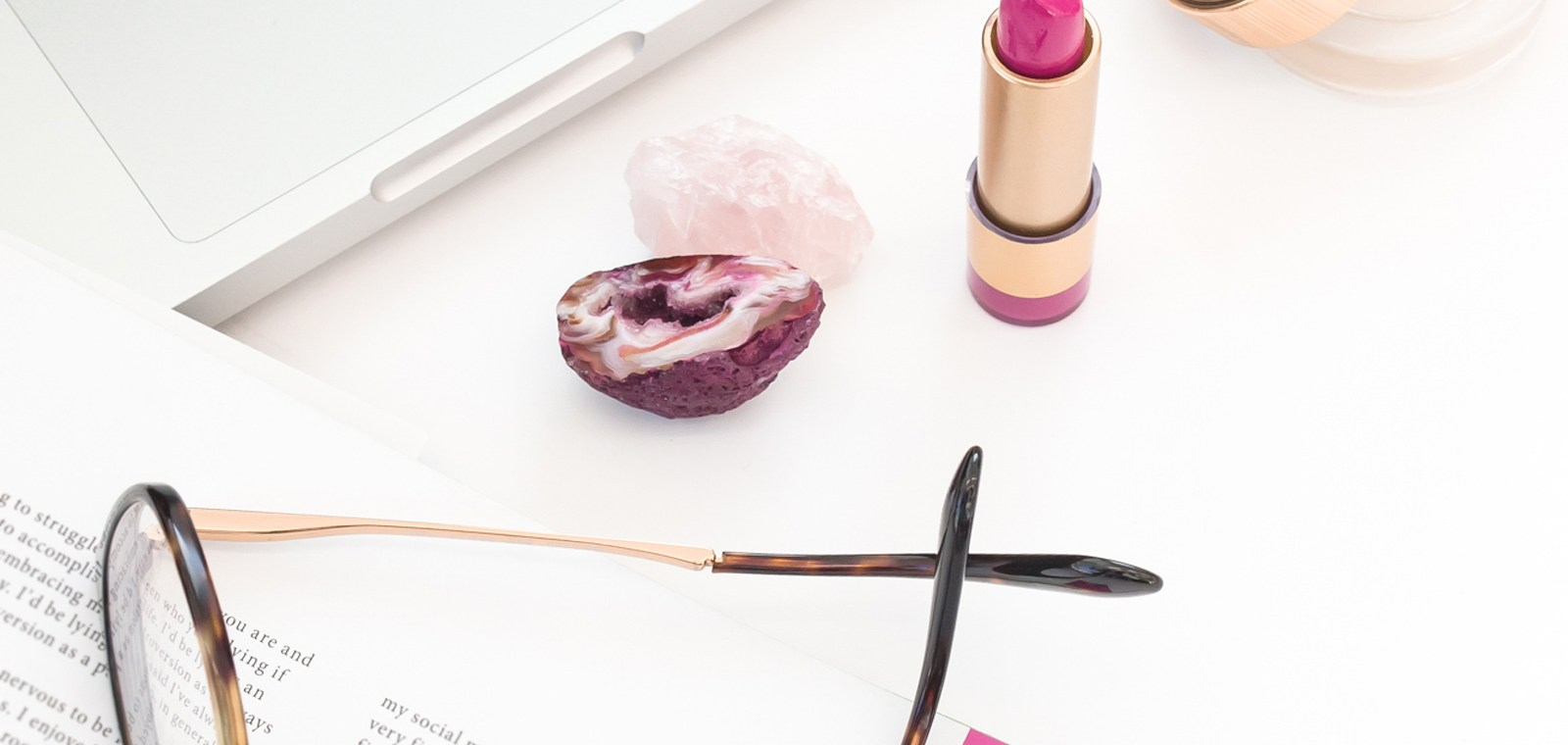 boho desktop with lipstick, glasses and crystals