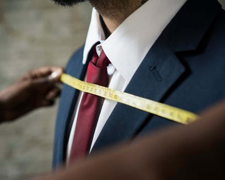 Man getting clothing measurements taken
