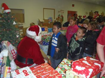 Santa Distributing Gifts 2012