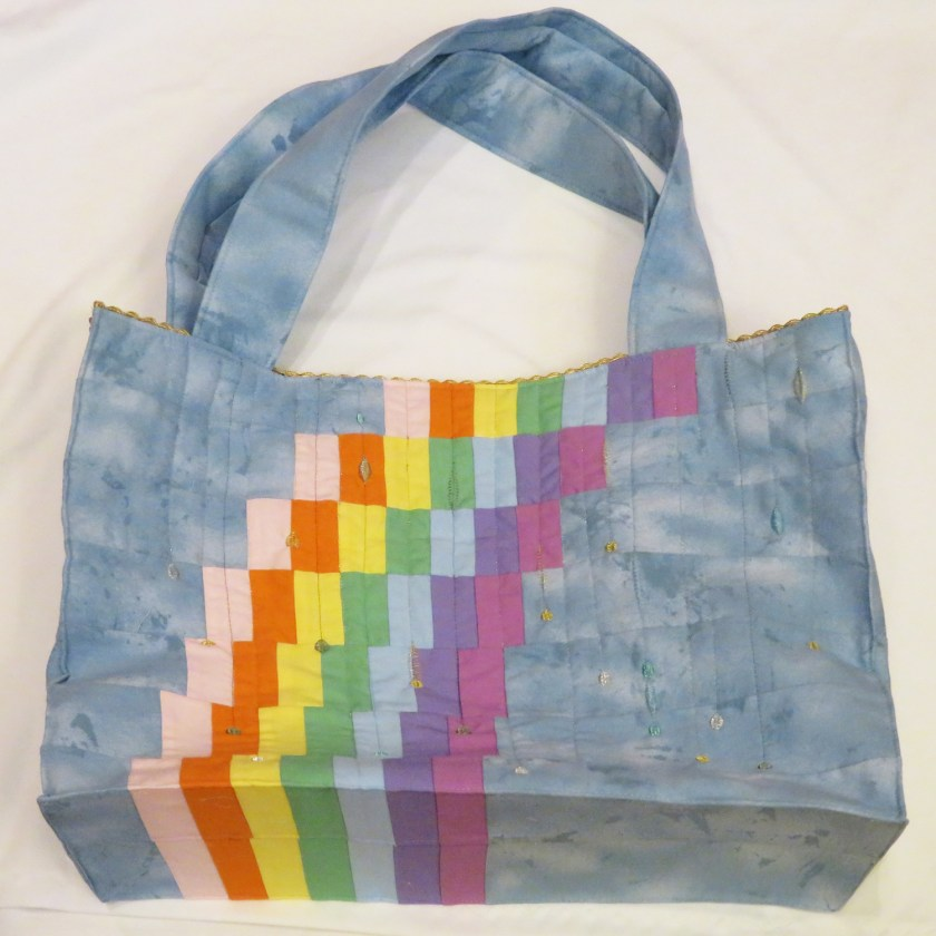 This image has an empty alt attribute; its file name is Rainbow-Bag-photo-by-LJ-Christensen-1024x1024.jpg