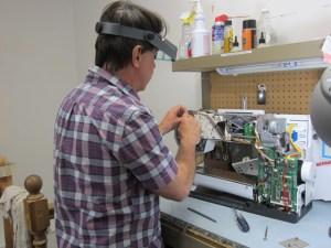 Sewing machine repair technician