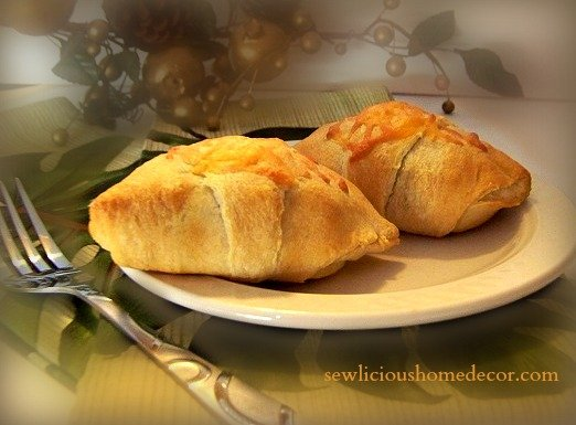 Creamy Taco Puffs. Crescent rolls filled with taco meat topped with cheese. sewlicioushomedecor.com
