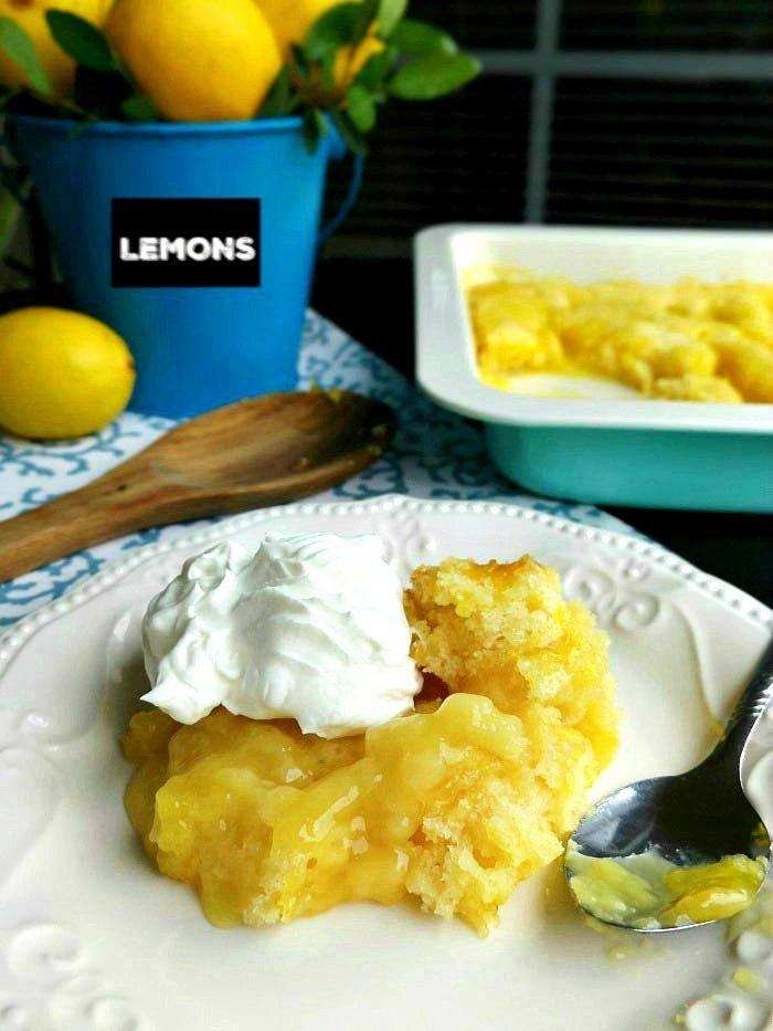 Best Lemon Pudding Cobbler Cake Recipe topped with Cool Whip sewlicioushomedecor.com
