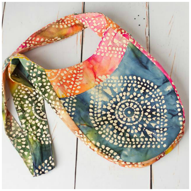 India's crossbody boho vibe appeals to the flower child in all of us. Tie a knot in the long strap to wear it as a shoulder bag. Two open pockets and two zippered pockets will keep everything organized. And it's even reversible so be sure to choose a lining fabric wisely. Two size options included.
