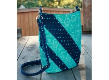 Ramona is a slim hipster-style bag with an adjustable crossbody strap. A recessed zipper keeps your things secure and an oval-shaped bottom provides just enough room for it all. She's a relatively fast sew and easily customizable.