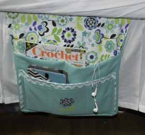 Place-the-Caddy-under-the-Mattress-with-the-Pockets-Hanging-Down-300x278 Pretty Little Bedside Caddy