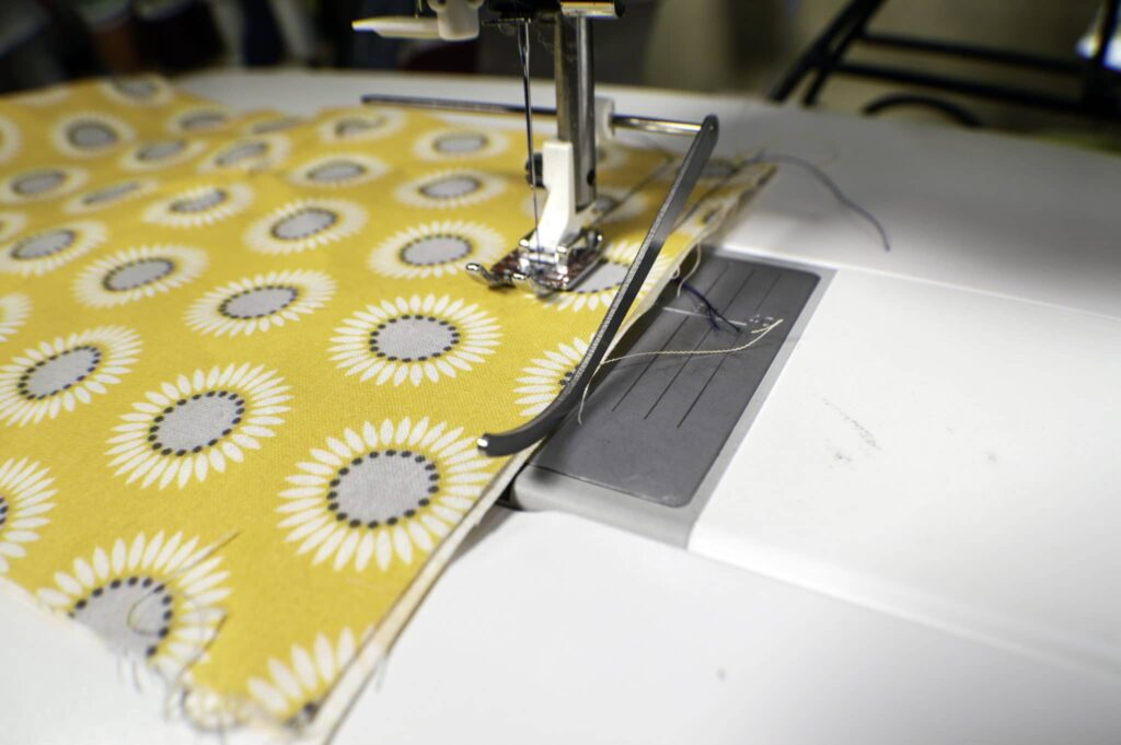 Line-up-Your-edge-guide-with-your-raw-edges-1024x681 Learn to Sew: How to Easily Sew a Straight Line