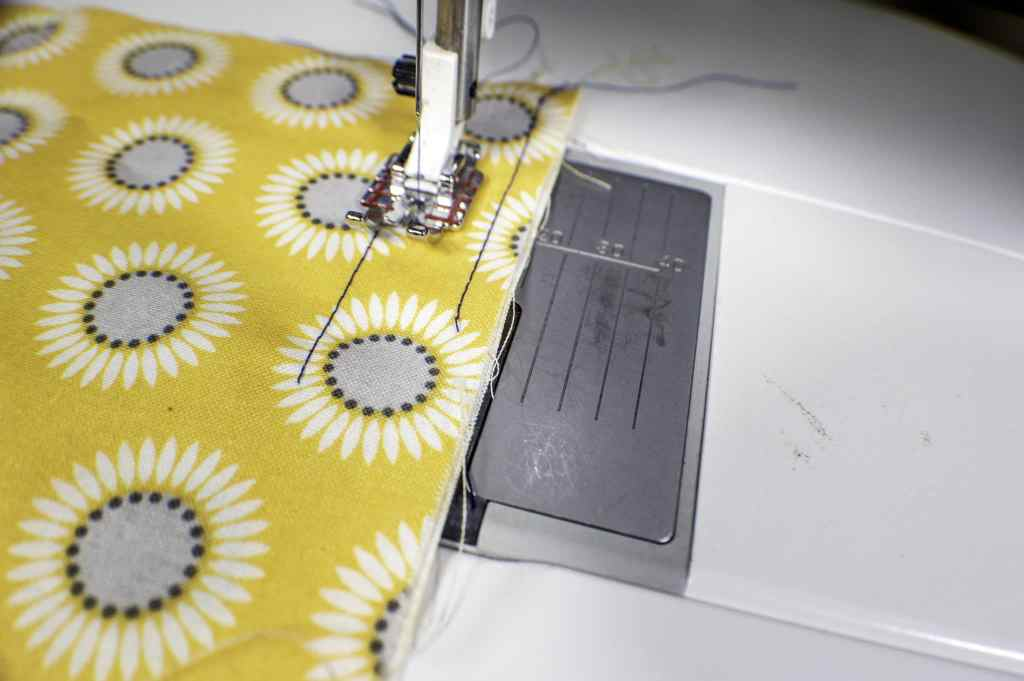 Line-up-the-Raw-Edges-wirh-the-Sole-Plate-Markings-1024x681 Learn to Sew: How to Easily Sew a Straight Line