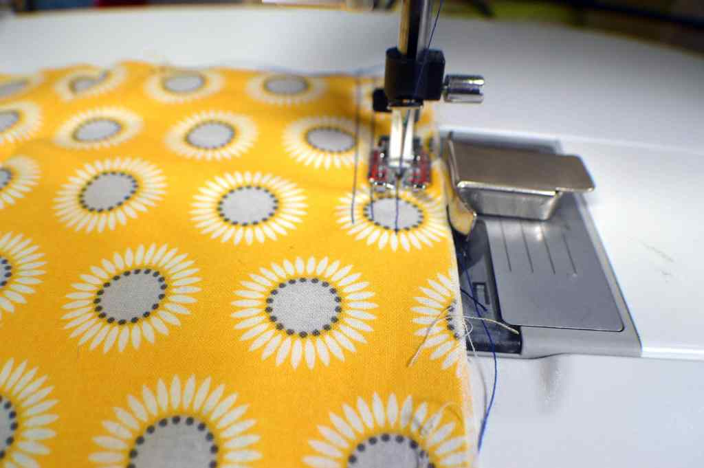 Place-your-edges-against-the-magnetic-guide-1024x681 Learn to Sew: How to Easily Sew a Straight Line