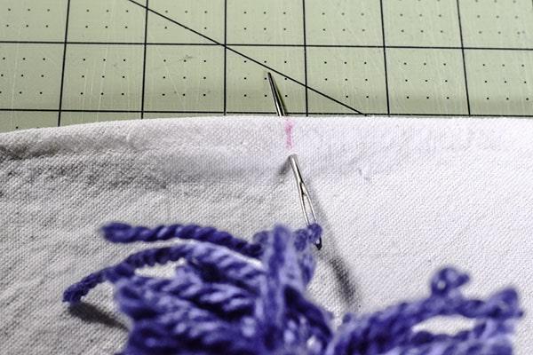Make a drop cloth pom pom throw