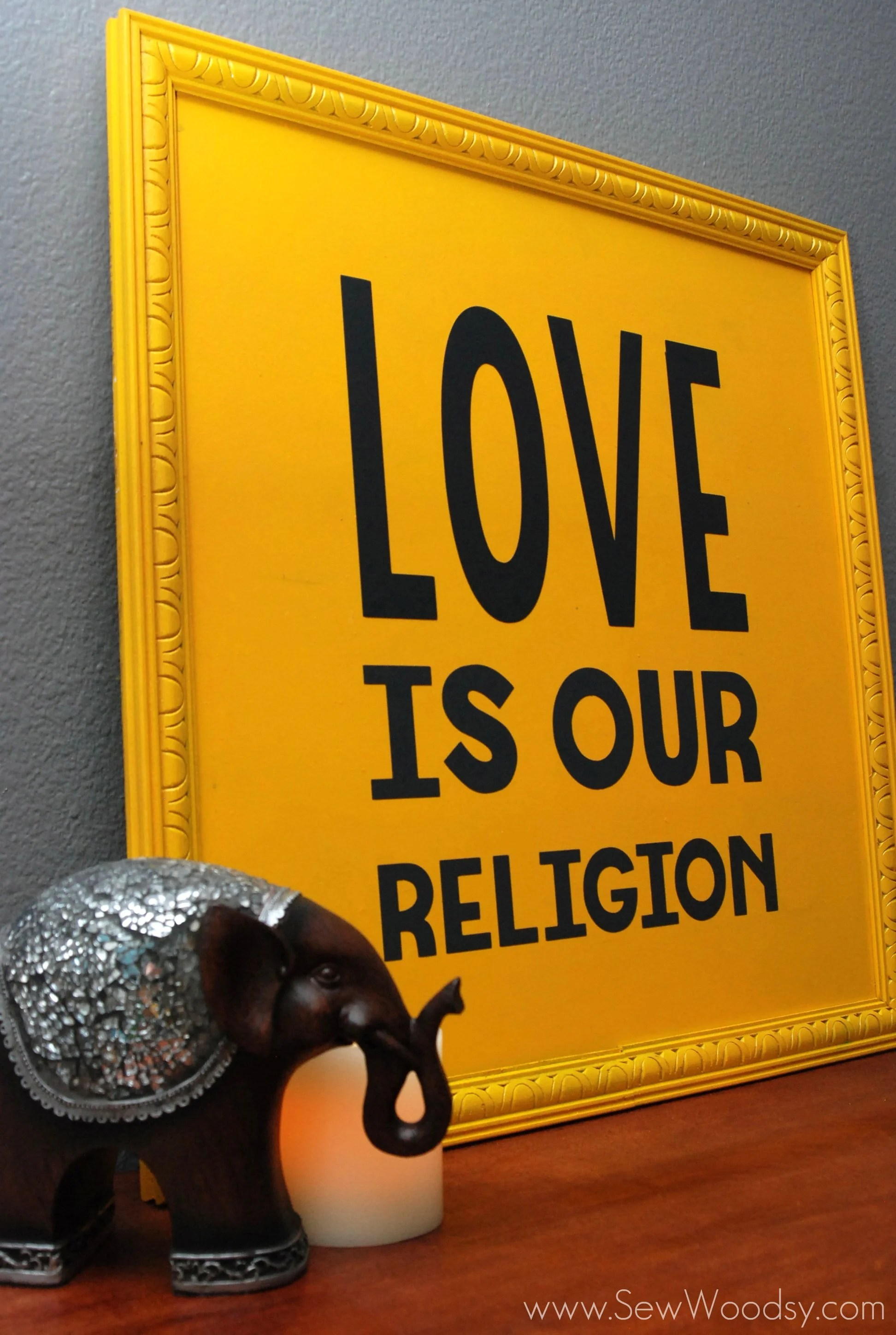 love is our religion sign