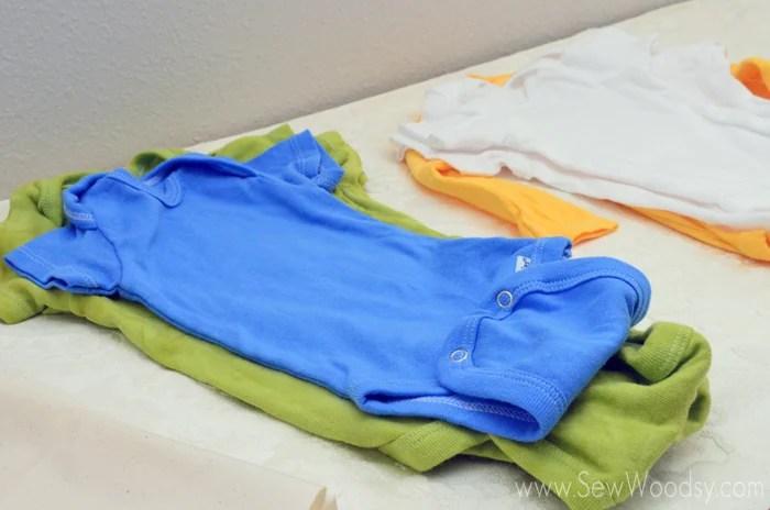 Baby Shower Onesie Station using Cricut Iron-On Vinyl #babyshower #DIY #Craft #Cricut