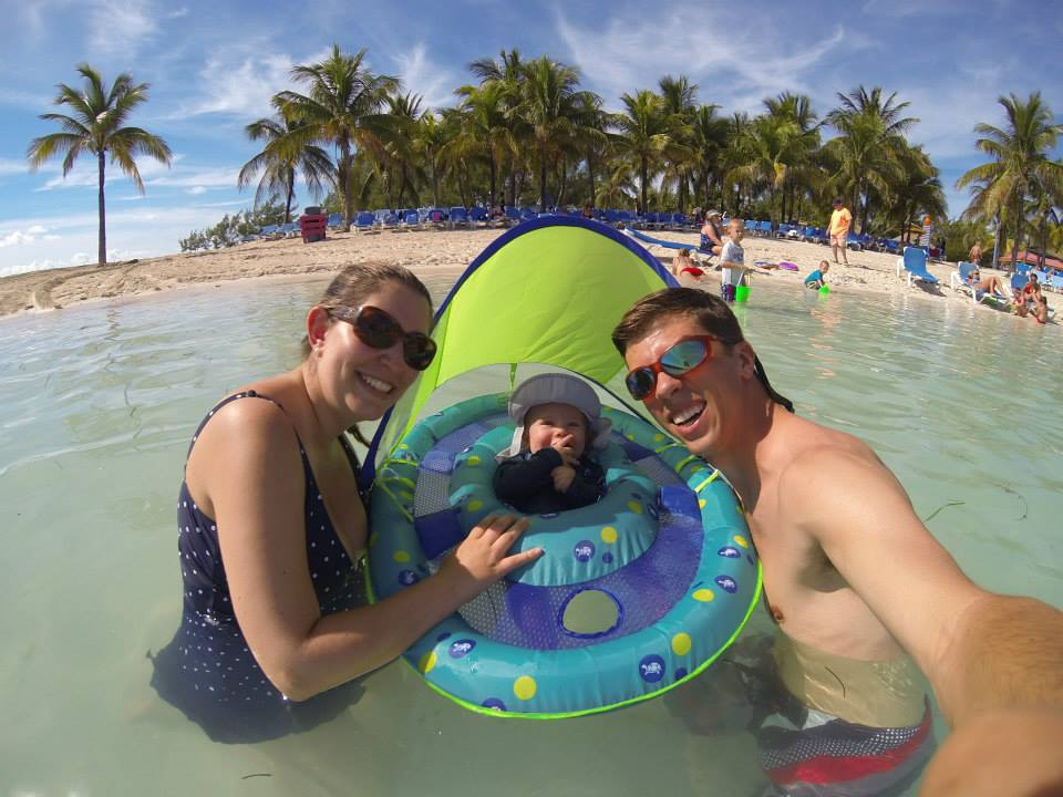 Cruising with an Infant family photo on coco cay