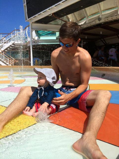 baby in the splash pad on cruise