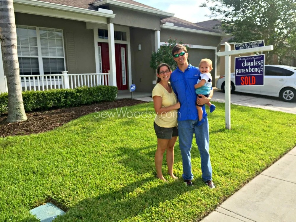 Family in front of first home
