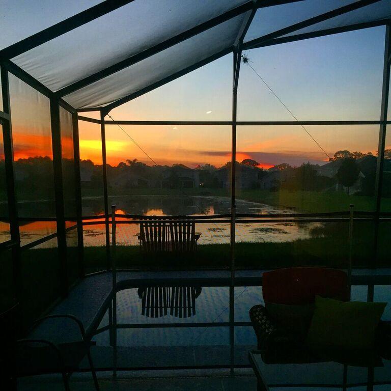 orange sunrise at florida pool home