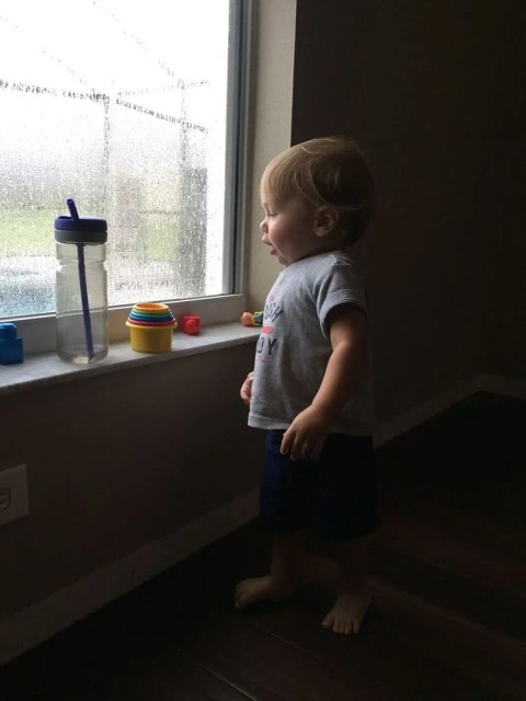 ryder playing in his make-shift play room on a rainy day