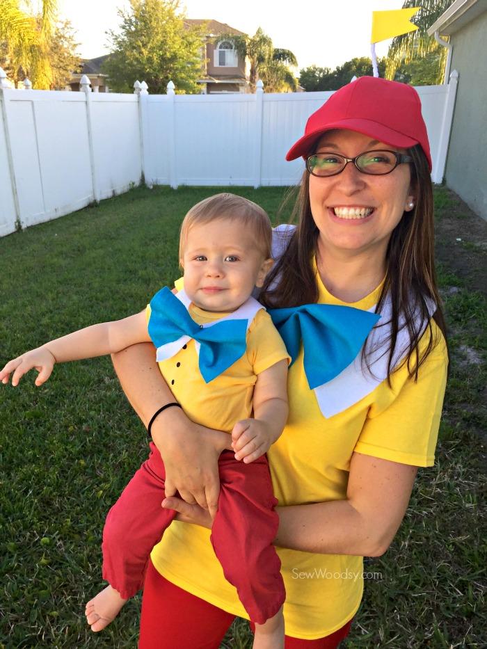 Woman and baby boy dressed as Tweedledum and Tweedledee.