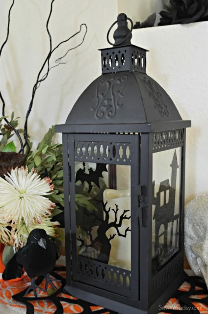 Haunted Lantern with DIY window cling using @OfficialCricut
