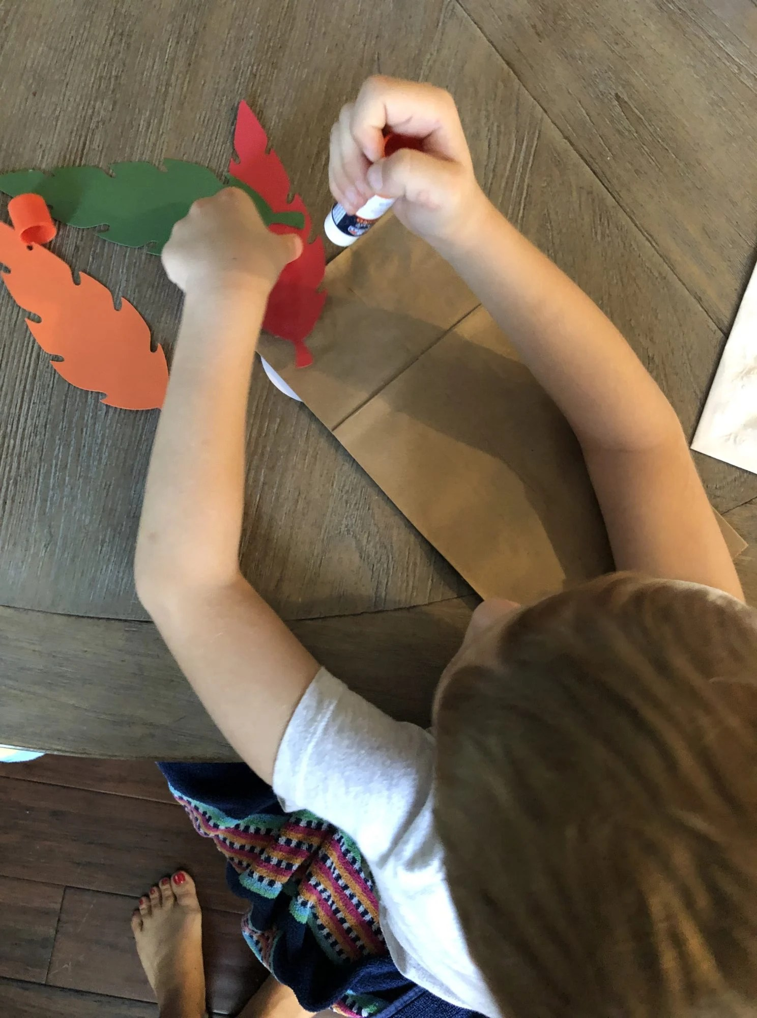 Turkey Paper Bag Puppets glueing feathers