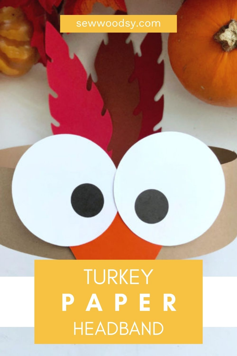 Up close of a turkey paper craft with text on image for Pinterest.