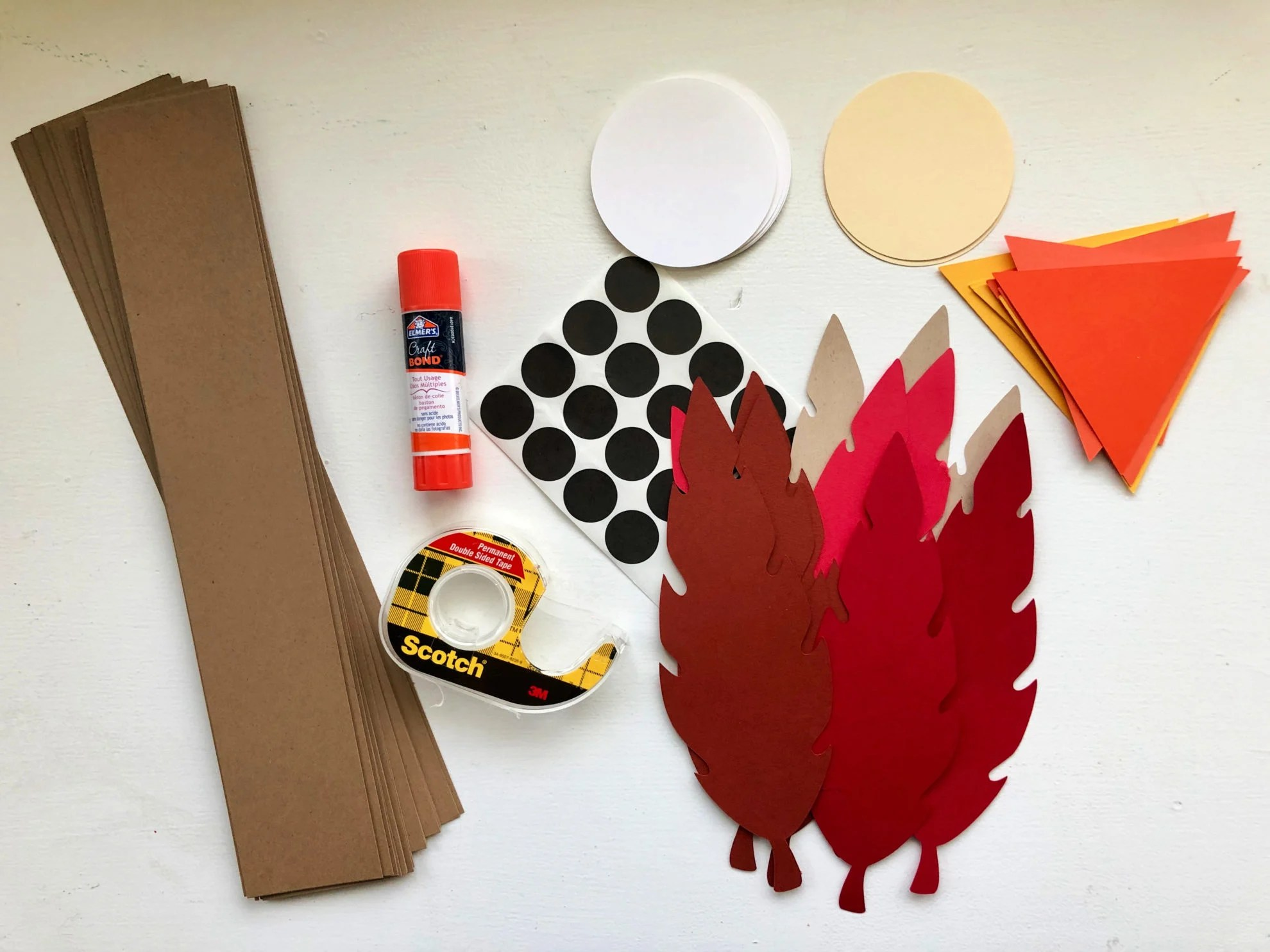 Supplies: brown card stock strips, paper feathers, orange paper beaks, tape, glue, black dots.