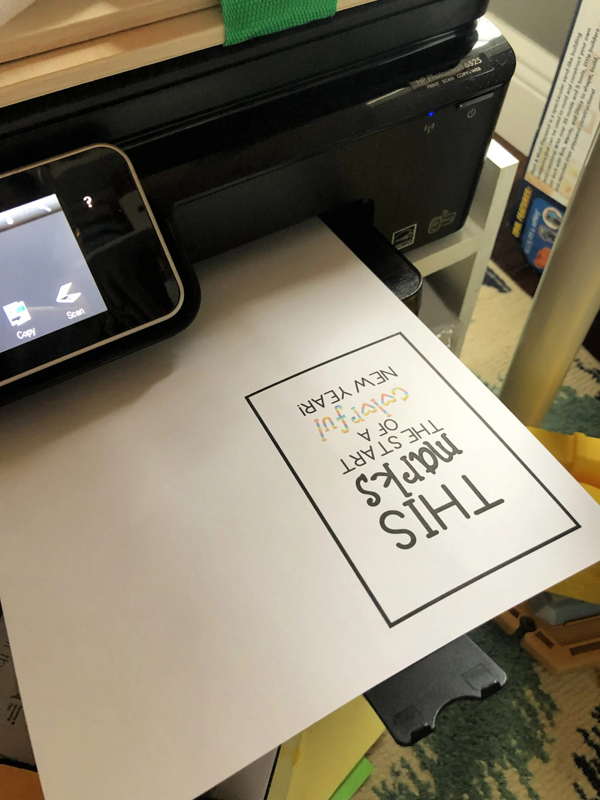 Black printer with a white paper printed with a rectangular box and print in it.