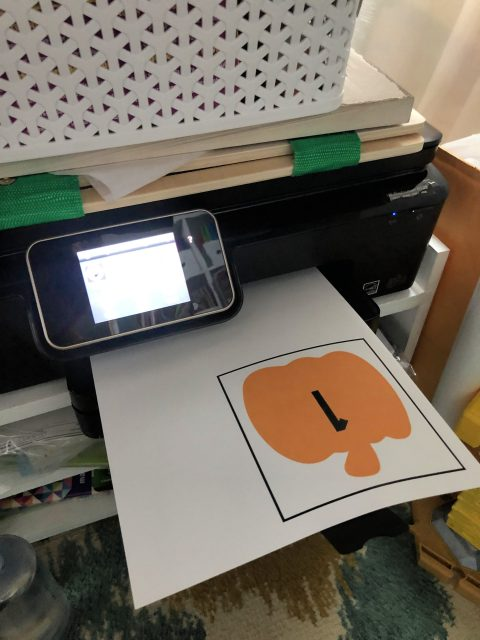 DIY Fishing for Numbered Pumpkins Game being printed on a printer