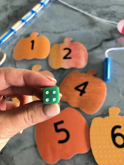DIY Fishing for Numbered Pumpkins Game using a dice!