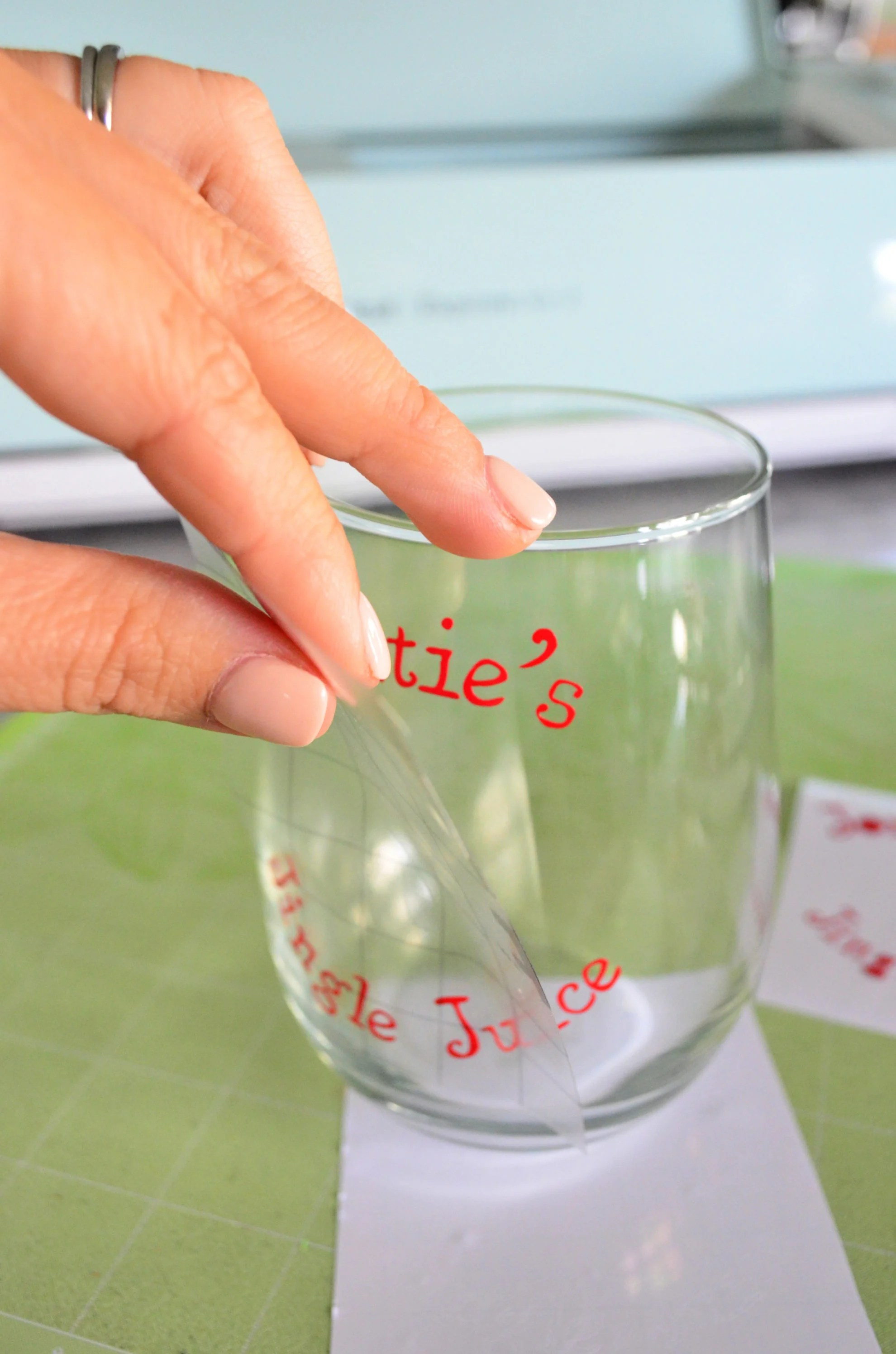 DIY Personalized Jingle Juice Wine Glasses applying vinyl to glass