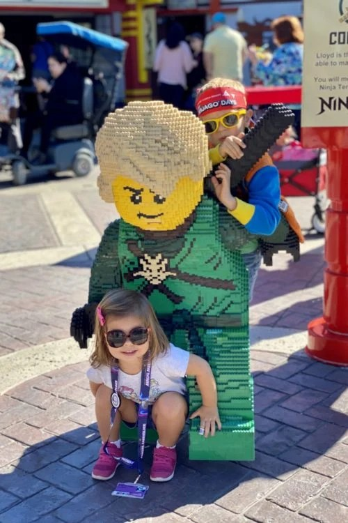 two children with LEGO Ninjago
