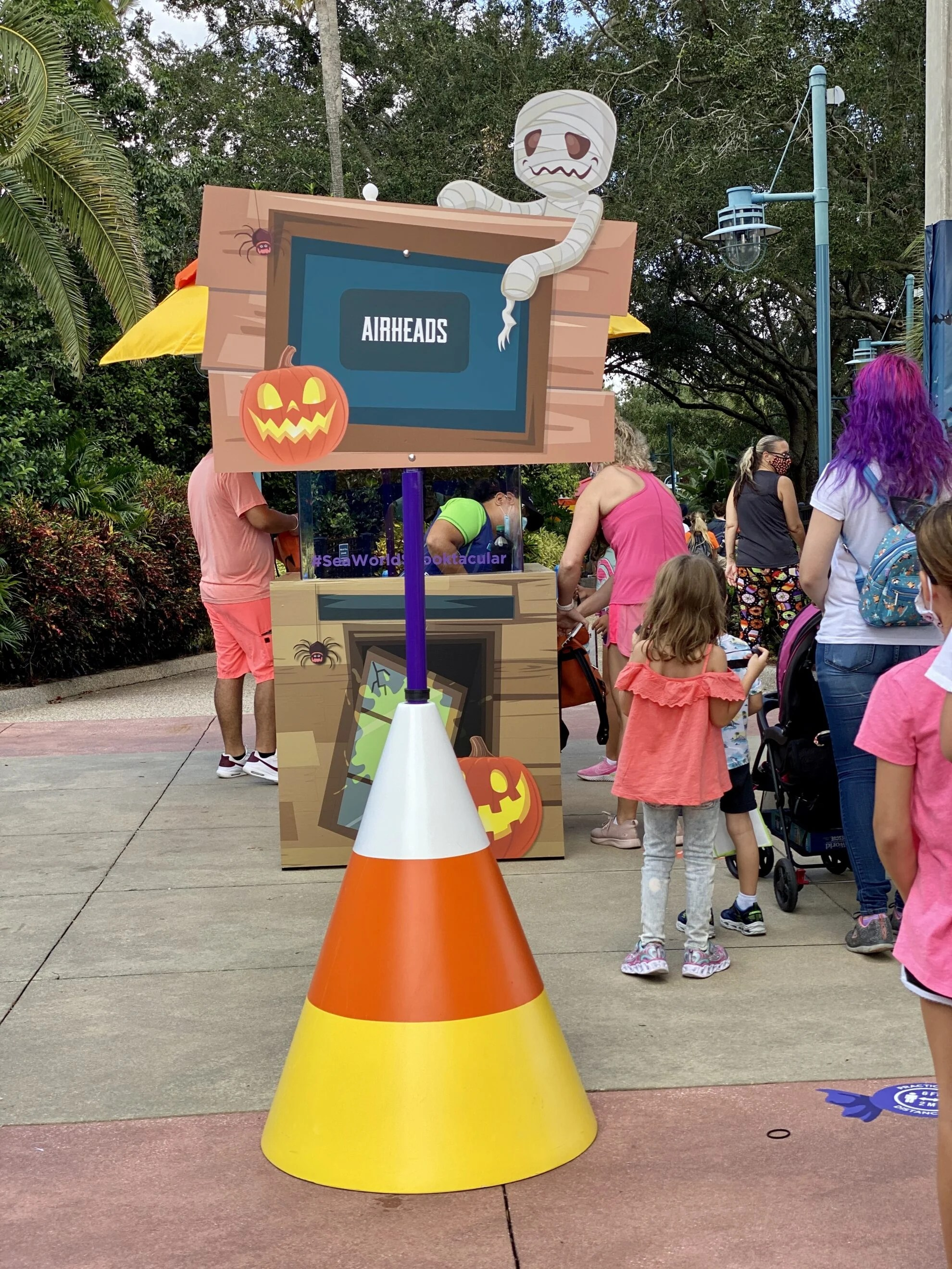 "Candycorn large cone with sign that reads ""airheads"" at Trick or Treat station SeaWorld."