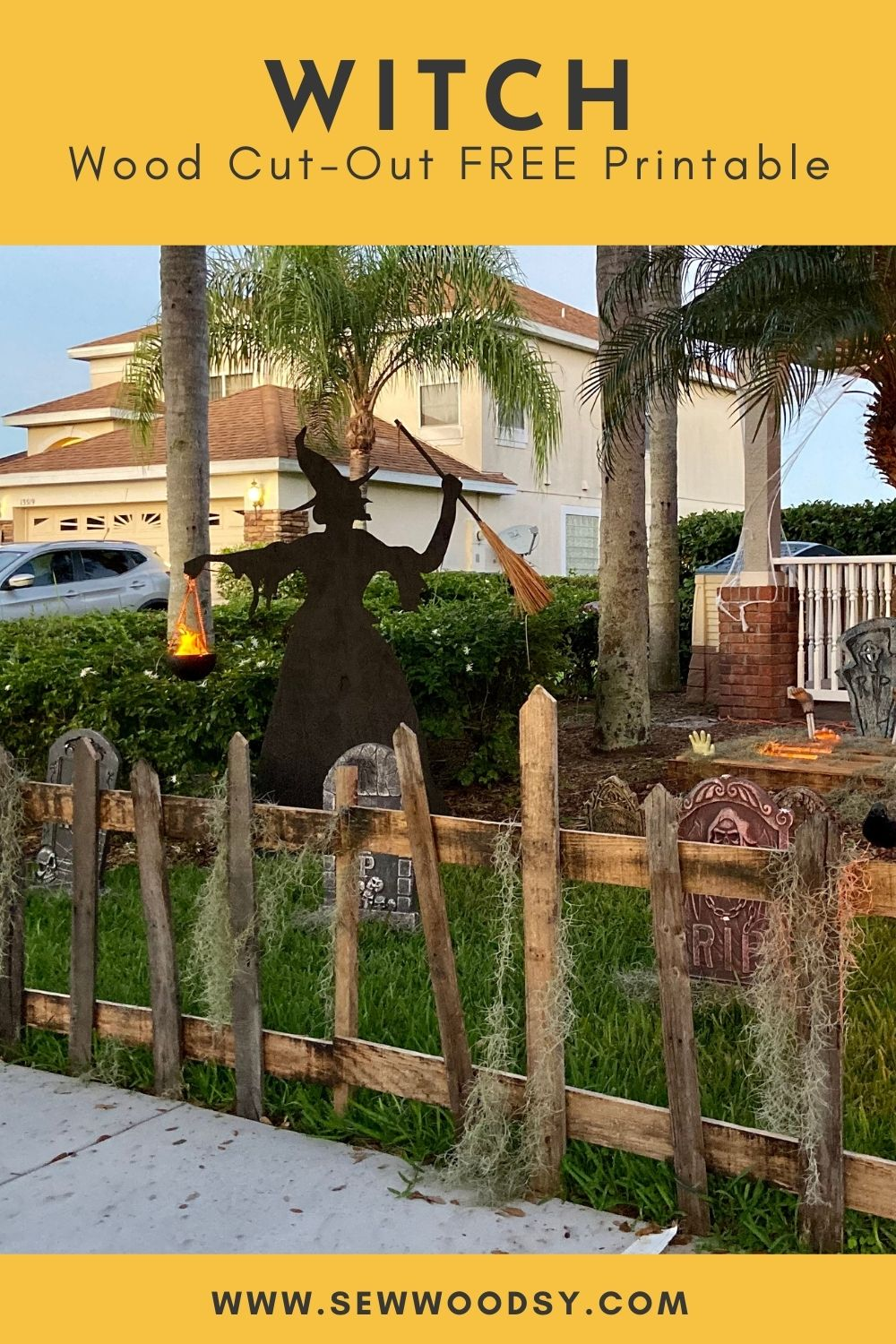 Wood pickett fence with a black silhouette witch in the background.