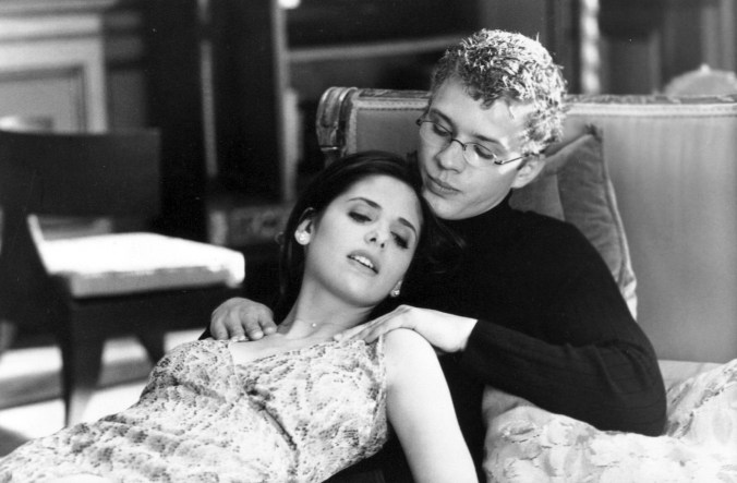 A black and white image of Gellar lying back against Philippe