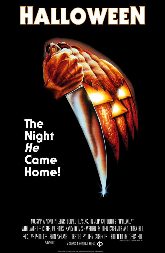 The Halloween poster, showing a fist and a knife made to look like the face of a jack-o-lantern and the tagline 'the night He came home'