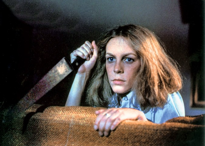 Image from Halloween showing Laurie holding a knife
