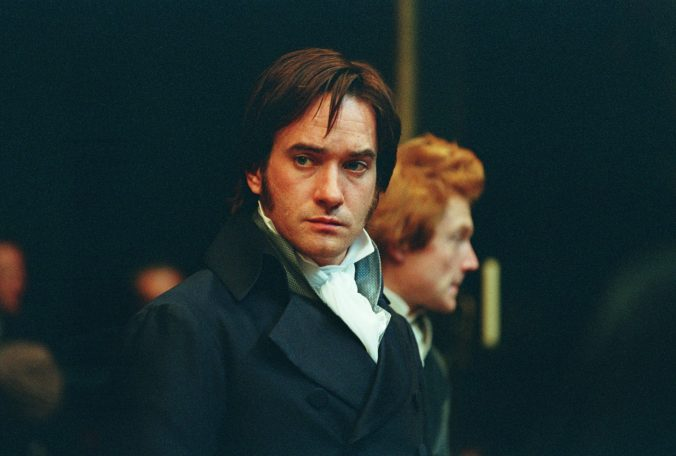 An image from Pride and Prejudice showing Darcy looking brooding