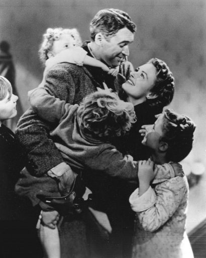 The famous image from It's a Wonderful Life of George being embraced by his family