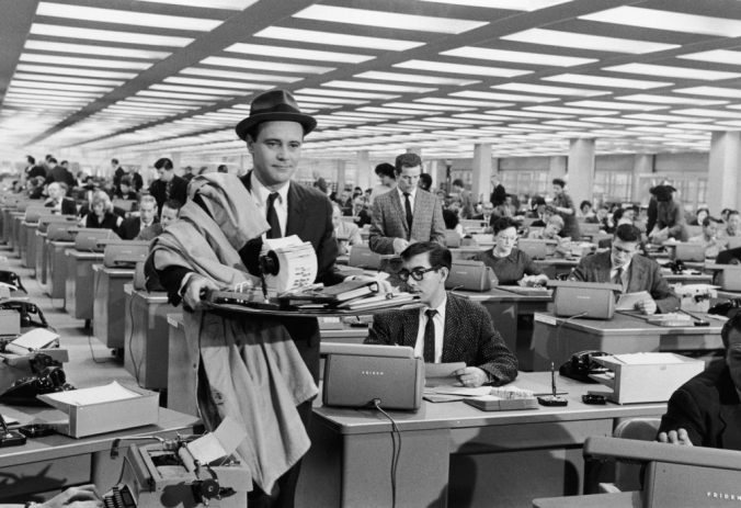 Jack Lemmon in The Apartment walking through his crowded office