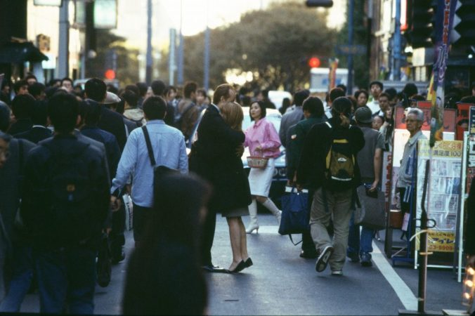 An image from Lost in Translation of Bob and Charlotte hugging in a crowd