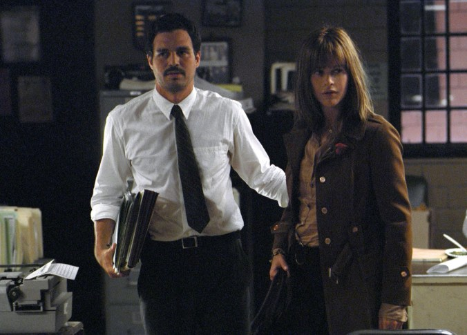 Malloy and Frannie in a police station