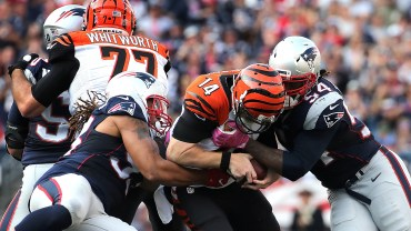 FOXBORO, MA - OCTOBER 16: Dont'a Hightower #54 of the New England Patriots and Jabaal Sheard #93 sack Andy Dalton #14 of the Cincinnati Bengals in the second half at Gillette Stadium on October 16, 2016 in Foxboro, Massachusetts. (Photo by Jim Rogash/Getty Images)