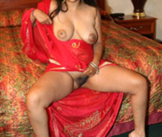 Busty Indian Arhuarya Lifts Up Her Red Sari To Show Off Her Hairy Hole