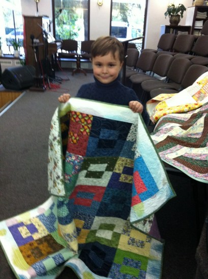 Nikita, Ukraine; a quilt to remember his father, lost to war