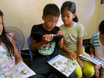 Sayha reading the bible for the other three. The two on the right joined in only yesterday so he and Jantee pointed to all the pictures and explained what we had already learned :) melt my heart!