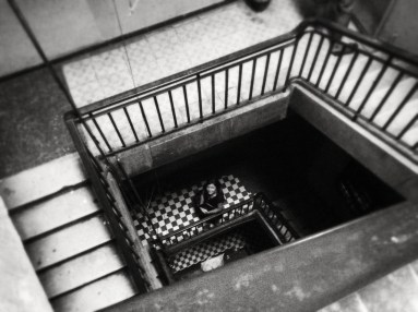 """A lot of Phnom Penh has stairwells. Dark, dirty stairwells that seem to all have at least 4 if not more levels. """"Exercise, exercise those thunder theighs!"""" Haha used to sing that as a kid."""