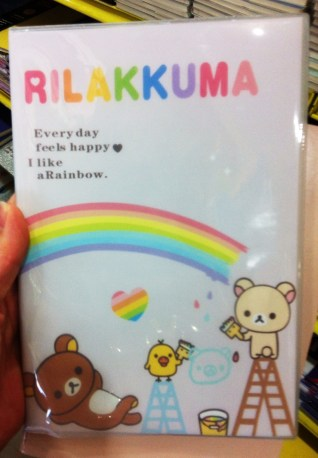 """There seems to be a never ending supply of stupid notepad sayings. This one says """"Rilakkuma. Everyday feels happy. I like a Rainbow."""""""