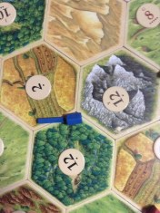 This is why i don't play Catan. I make foolish mistakes like this one and actually place a settlement here. Part way into the game I fully realized that everyone else was picking up cards everytime the dice rolled....and not me! At LEAST I got blue houses....love blue!