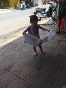She was opening and closing the newspaper just like her dad :)
