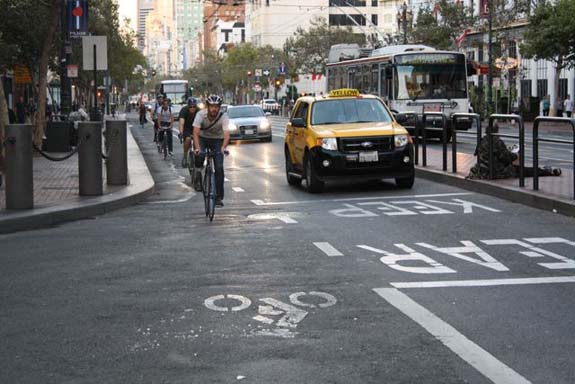 This bike lane on Market Street between 8th and 9th still hasn't been protected or painted green. Photo: Bryan Goebel.
